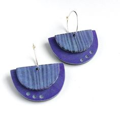 Convertible earrings - mix and match the two sided components for the look you want. Each polymer clay half circle has two different sides - a