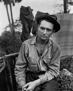 """""""A migrant labourer waiting for work in one of the packing houses near Canal Point, Florida, 1939"""". Marion Post Wolcott."""