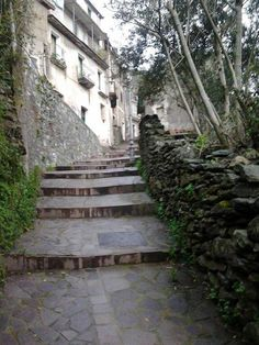 Handiwork of local stone masons on display in the walls and stairways of Conflenti, Calabria Italy.