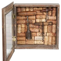 Handcrafted one-of-a-kind shadowbox features a collection of corks from Italian wineries with rare vintage corkscrews.