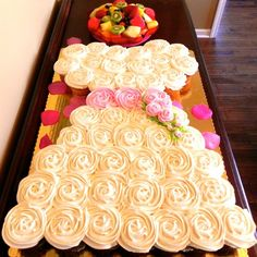 Or skip the cake entirely with this adorable configuration of cupcakes!See more photos from this bridal shower on a budget ►Photo Credit: Claudia Hernandez