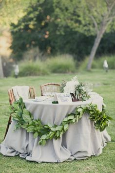 Love having a special table for you two...also the greenery style is similar to the other 'wreath' I pinned to shoe how cool it looks with the font of the 'sweetheart' sign