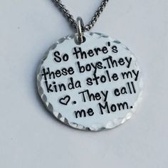 Hand stamped pendant with the saying: So there's these boys. They kinda stole my…