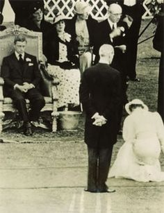 King Edward VIII bored & improperly dressed for a State Occasion, receives debutantes during their Presentation at Court, Buckingham Palace Garden, 21 July 1936.
