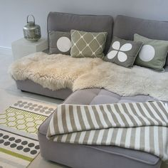 Pappelina cushions, blankets at rugs full range available at Lotta From Stockholm