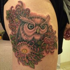 Great and cool tattoo   @coastlinetattoo -  @cocheese323 made this awesome owl and chrysanthemums! . #owl #owls #owllove