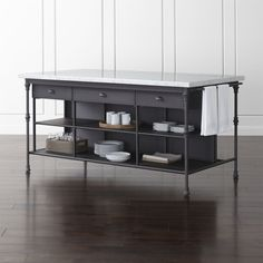 "Shop French Kitchen 72"" Large Kitchen Island.   Prized for its natural grey-white veining, the top's expansive Carrara marble is perfectly matched to its classic black cast steel and aluminum base."