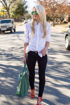 There are few wardrobe essentials that we lean on more than the classic white button-down shirt. It's the real deal: The true wear-anywhere closet staple. In crisp cotton or soft silk, its tailored shape brings elegance to distressed denim and conservative suiting alike. Just ask out fashion director, Jillian Davison, whose unofficial uniform is a white button-down and a black pencil skirt or sharp trousers. To wit, our fashion department dressed as Jillian for Halloween: Happy Halloween…