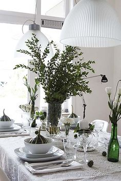 Fall table setting with a bouquet of leaves, green pumpkins and white china. It has that autumn feel without the traditional colors. via http://www.songbirdblog.com