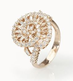 We love the unique swirl design of this gorgeous cocktail ring! A one-of-a-kind design means no one else is stealing our thunder! Plus, we can't get over the added layer of intrigue from the baguette and round diamond combination!  | 1.29ctw Round And Baguette White Diamond, 18k Rose Gold Ring [Promotional Pin]