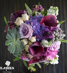 Varying shades of purple and greens in wedding bouquet. includes lavender roses…