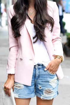 Kat Tanita is wearing a pink blazer from Rebecca Taylor, ripped denim shorts from Rag & Bone and a white clutch from Lauren Merkia