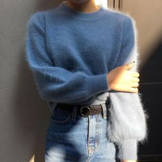 The  blue fluffy sweater