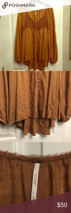 Free People peasant tunic. Free People peasant tunic in burnt orange. Uneven whimsical hem. Hi-lo style. Size M but runs oversized! Gorgeous piece and in excellent condition. No trades. Free People Tops