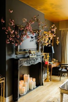 Candles in fireplace! I love the clever use of candles and a fake mantle to give the illusion of a fireplace. Beautiful wall color too. Candles In Fireplace, Black Fireplace, Fireplace Facade, Pillar Candles, Fireplace Wall, Fireplace Modern, Fireplace Design, Simple Fireplace, Large Candles