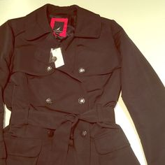 Classic Nautica trench coat Brand new women's navy blue Nautica rain slicker with nautical anchor buttons. The buttons are silver and navy blue. Tags attached. 100% polyester with polyester lining. Nautica Jackets & Coats