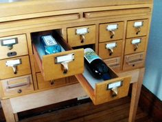 vintage card catalog as wine bottle storage