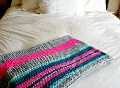 I can not believe that I am finally writing this post. I FINISHED my first knit blanket!  It feels as though I've conquered some unobtainable feat. Oh. My. Goodness.  I bought the yarn just after New Year's Day (carefully hiding the receipt from my husband because of the unusually large yarn purchase. It's a blanket for Pete's sake, it...