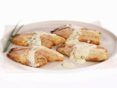 Broiled Tilapia with Mustard-Chive Sauce: Giada De Laurentiis drizzles broiled white fish fillets with a simple, creamy sauce for a meal that's ready in under 20 minutes, but tastes like you slaved all day.