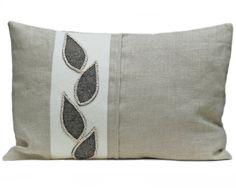 Linen and wool felt cushion with natural leaf design