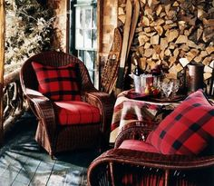 Cozy cabin porch - bold red and wood feels so warm