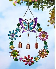 The Metallic Garden Wind Chime is a melodious addition to your outdoor decor. Three bronze tone wind chimes are surrounded by a metallic floral wreath with a wi