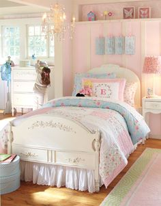 What a beautiful room for a little girl. Love the soft, feminine colors of this Pottery Barn Kids Room. I particularly love the cozy floral quilt and ornate chandelier.