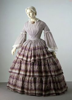 Dress  Place of origin:  UK (made)    Date:  1858-1860 (made)    Artist/Maker:  Unknown (production)    Materials and Techniques:  Printed cotton, trimmed with whitework embroidery, hand-sewn    Credit Line:  Given by Messrs Harrods Ltd.    Museum number:  T.702-1913