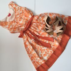 """Elle Orange Patterned Dress Elle Orange Patterned dress with an elastic waist and a beautiful sash tie. Only worn once!! A little pleating at the chest. 18"""" armpit to armpit and 36"""" long. NO TRADES. Elle Dresses"""