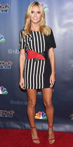 Heidi Klum showed off her best assets (her enviably long stems) on the America's Got Talent red carpet in a black-and-white striped shift that she cinched with a red-and-black crossover belt. The finishing touch? Red ankle-strap sandals.