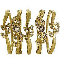 Relic Vine bands in 18k gold with 0.02 ct. t.w.–0.13 ct. t.w. natural-color diamonds; $825–$1,265; Dawes Design for Diamonds With a Story, Santa Rosa, Calif.; 888-802-0880; dawes-design.com
