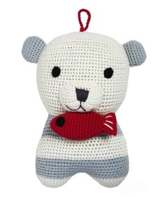 "Soft and organic, Smilla the polar bear is hand crocheted from organic cotton making her as Earth-friendly as she is adorable. When little ones pull on her tasty little fish, Smilla will play Schubert's ""Lullaby"" for their auditory enjoyment."