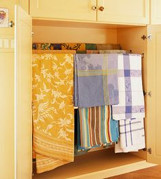 Cabinet fitted with dowels for linen storage--never have to scramble to iron the tablecloth! Brilliant Organisation, Kitchen Organization, Kitchen Organizers, Linen Storage, Clothing Storage, Towel Storage, Bathroom Storage, House Ideas, Cabinet Drawers