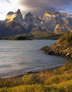 Lenticular clouds at sunset over the Cuernos del Paine from the shore of Lago Pehoe, Chile (by craigwhitmore).