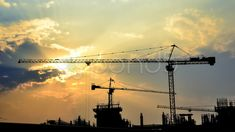 Time lapse sunset and silhouette crane  working in construction site - Stock Footage | by Punya Family