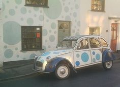 Here is the Spotted Art Car in front of the Spotted Art House. By the way these were done by two different people in England, what an amazing coincidence.