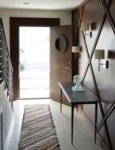 This could look great - something totally different - would paint tone on tone.  harlequin pattern on walls would be easy diy with chair railing .... creates great focal point!