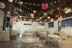 strings of lights and festive paper lanterns add bright splashes of color to this reception area
