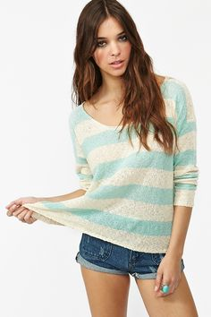 Shore Thing Knit   Lightweight aqua and cream stripe knit featuring a scoop neckline and loose weave. Ribbed at cuff and hem. Looks cute tossed over a bikini and cutoffs!