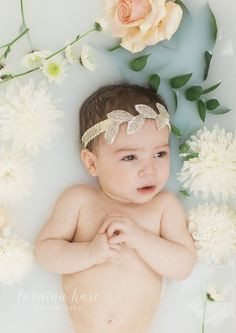 I can't lie, after doing this shoot, I am completely in LOVE with milk baths! I have been eyeing them for a while now, but never really came across any milk baths with babies! Baby girl did incredible! I'm a proud momma. :) I used my wedding garter as her headband, last minute decision, but i'm obsessed.