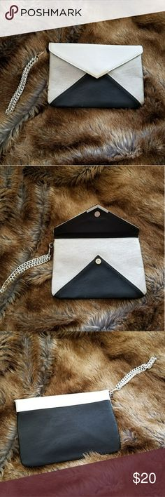 Express Silver, Black, and White Clutch with Silve 🎉NWOT🎉 Silver hardware, snap closure on this simple and sleek clutch from Express. Black, silver, and white in geometric areas. Classic. Pairs well with anything!   Spotless, perfect condition. Never used. Express Bags Clutches & Wristlets