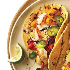 Blackening tilapia gives it a bold flavor, which is further enhanced with cilantro, lime, and avocado in a corn tortilla.