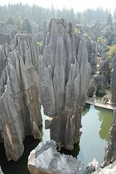 The Yunnan Stone Forest in China. Arrayed across acres. It is a region festooned with stone stalagmites, caves and other natural wonders. Places Around The World, The Places Youll Go, Places To See, Around The Worlds, Beautiful World, Beautiful Places, Wonderful Places, Beautiful Smile, Amazing Places