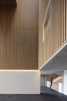 Wood clads the interior of the school's double-height foyer. Contemporary Architecture, Interior Architecture, Interior Design, Technical Architect, Japanese Apartment, Floor Slab, Weathering Steel, Building A Porch, Perforated Metal