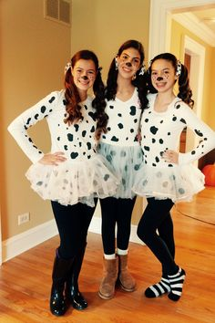 DIY Dalmatian Costumes!!! All you need is a white shirt, tutu, black leggings, black paint, black construction paper, black shoes, and if wanted, white and black polka dot ribbon! Paint dots on white shirt with black paint, cut circles out of the black construction paper and tape them to the tutu, put your hair in 2 pony tails, and add the ribbons if you want! Really easy and adorable!