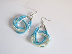 Handmade sky blue earrings realized with three beaded strands. These knotted earrings are very dainty and bright!  Wear this accessory in summer,