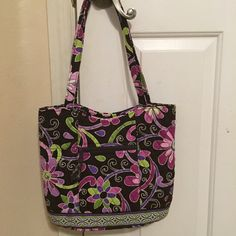 Vera Bradley Handbag This bag is in Excellent Condition. Also includes a wallet and coin purse that matches. The Wallet and Coin Purse are NWOT. Bundle deal unless buyer wants to separate. Vera Bradley Bags Shoulder Bags