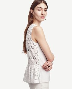 Pairing a luxe matte jersey front with an eyelet back, this cotton confection makes a sweet impact - coming and going. Back keyhole with hook-and-eye closure. Shirred back peplum. White Peplum, White Tank, White White, Long Sleeve Peplum Top, Peplum Tops, Long Tank Tops, Eyelet Top, Petite Tops, Ann Taylor