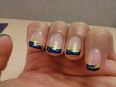 This is inspired by a design I found here on pinterest and since I love the St. Louis Blues hockey team, I decided to have the nail tech do a blue and yellow. This is also done in shellac.
