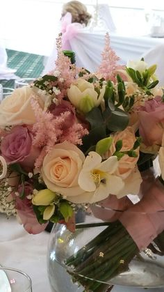 Rose bridesmaid bouquet with fresias and babies breath. Vintage dusky pink and white